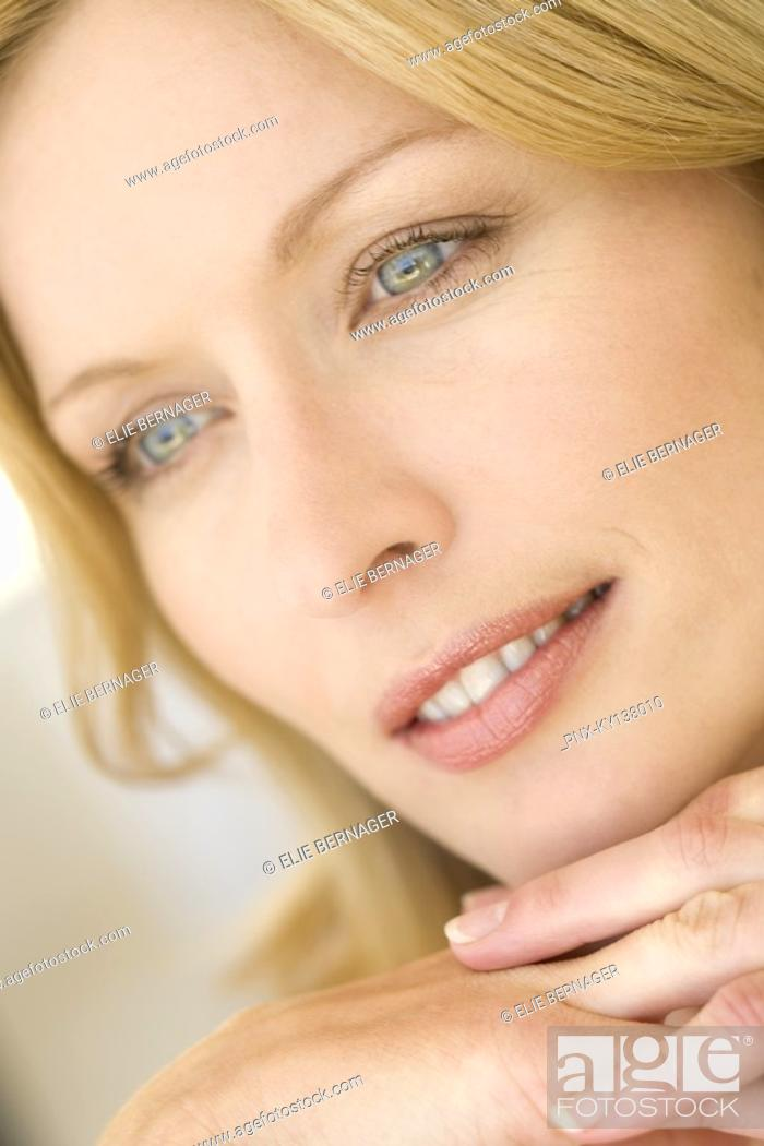 Stock Photo: Portrait of a young thinking woman.