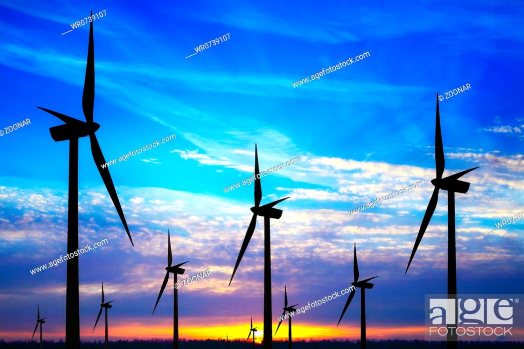 Stock Photo: Windpark at sunset.