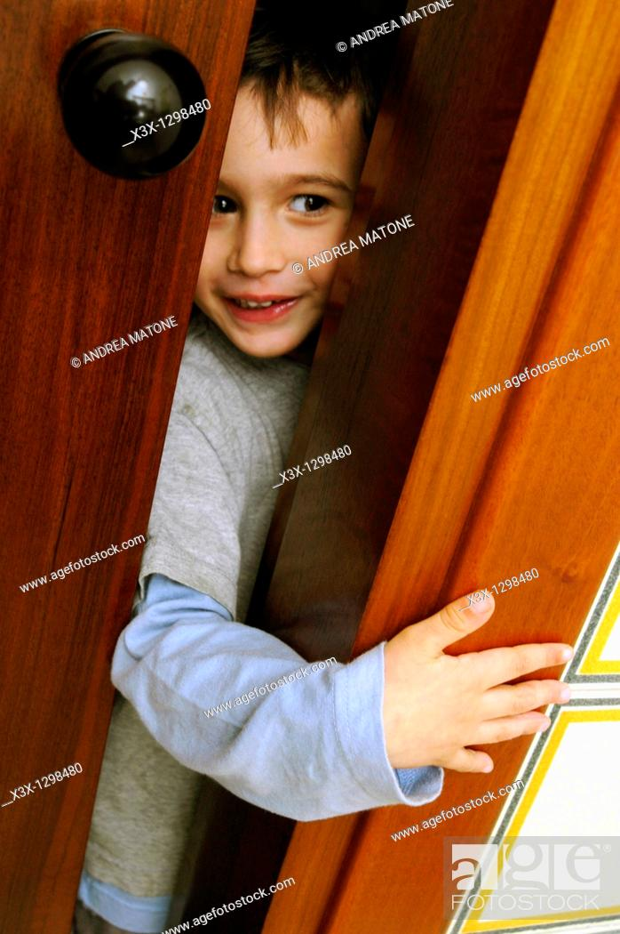 Stock Photo: A child playing hide and seek.