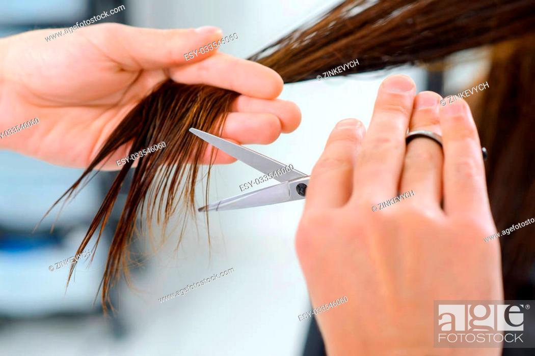 Stock Photo: Endings trimming. Close up of hair endings trimming procedure.