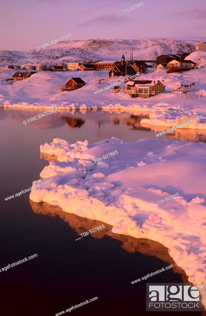 Stock Photo: View of Ilulissat from the sea in spring at sunset, Disko bay, Greenland.