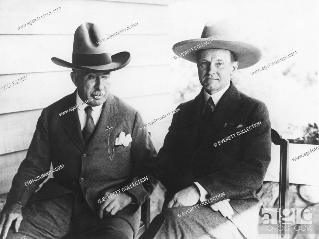 Stock Photo: President Coolidge in a 5 gallon hat, while Gen. Leonard Wood had the regulation 'Wild West' topper. Wood, Governor General of the Philippine Islands.