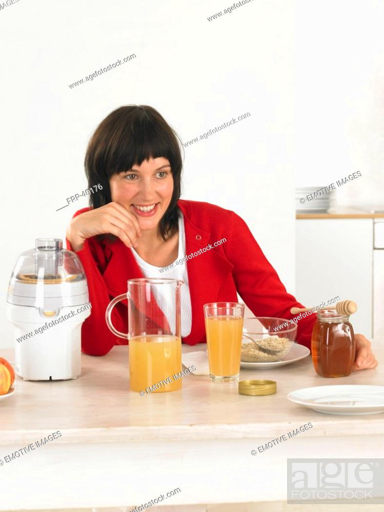 Stock Photo: Woman at breakfast table.