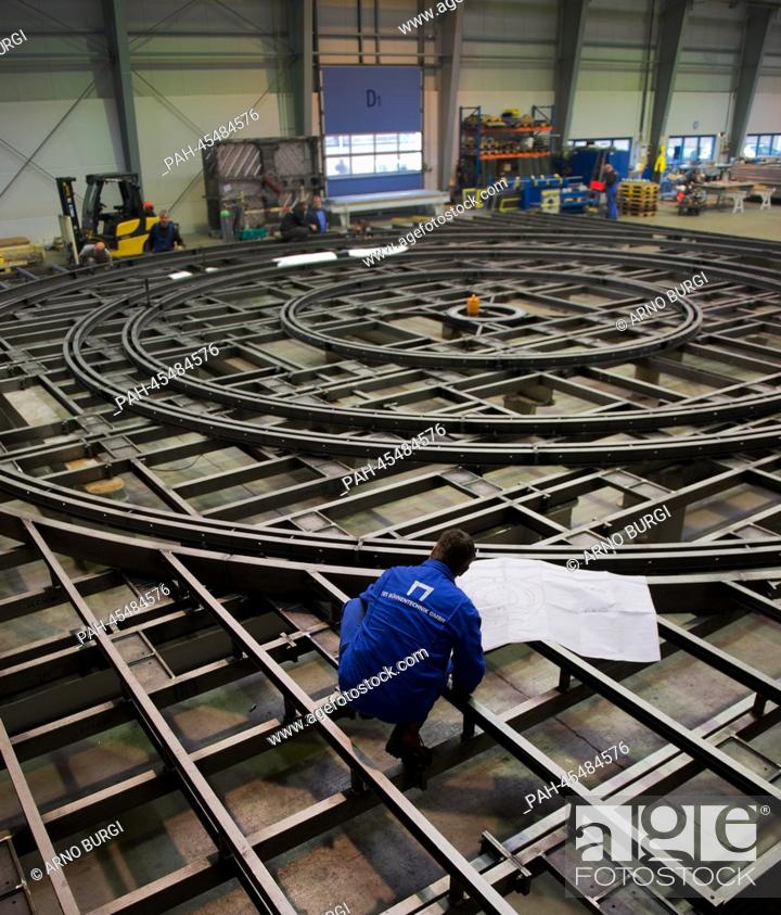 Photo de stock: An employee of the stagecraft company SBS Buehnentechnik GmbH works on a revolving stage for a theatre in Surgut, Russia, at the factory grounds in Dresden.