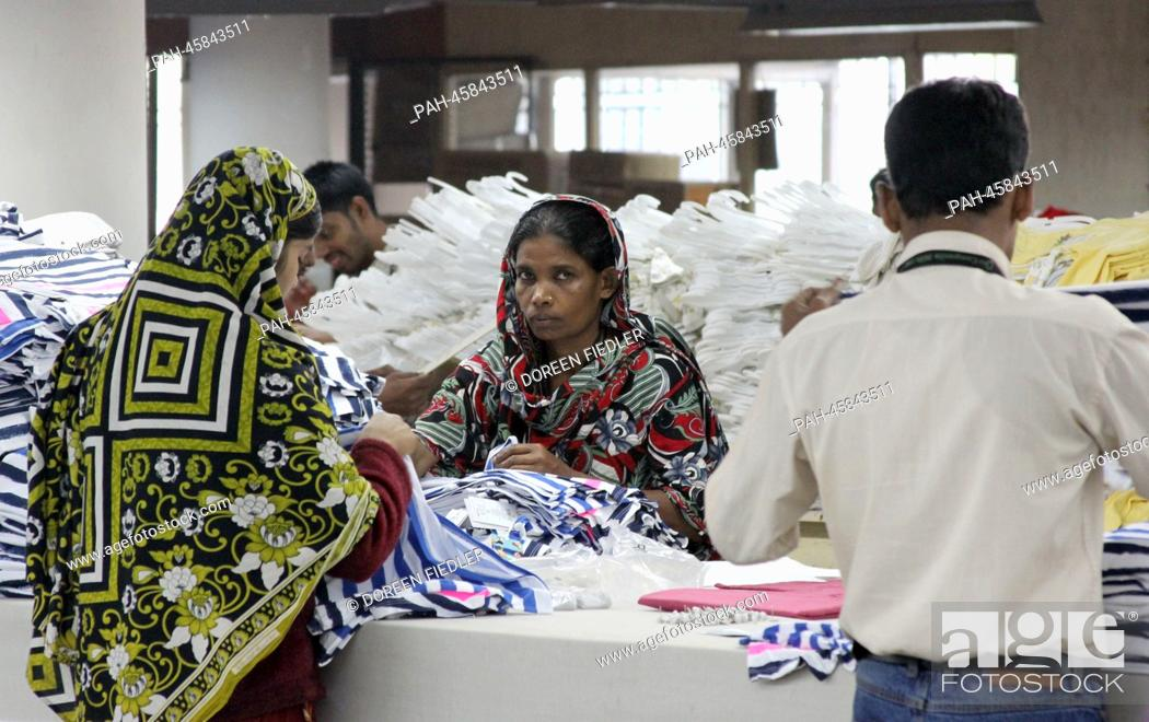 Women and men work in the textile factory 'One Composite