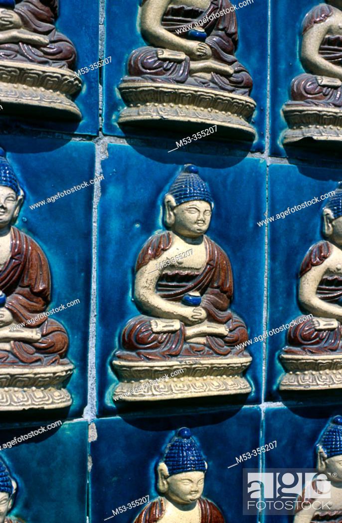 Stock Photo: Glazed tiles with Buddha, White Dagoba Temple, Beihai Park. Beijing. China.