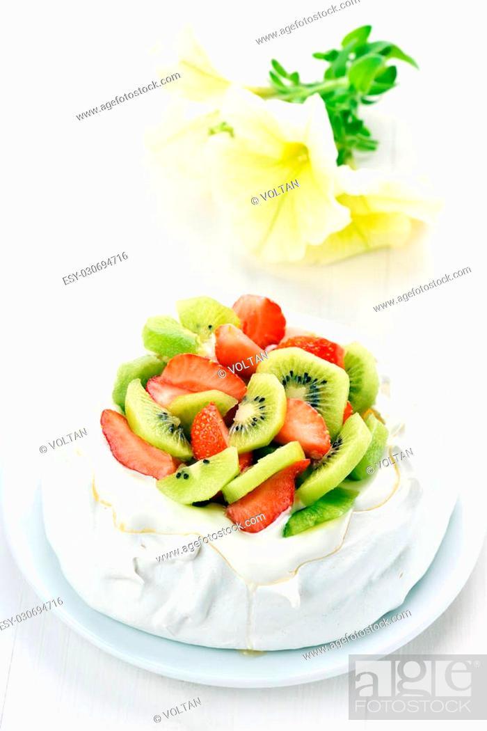 Stock Photo: Pavlova meringue cake with strawberries and kiwi.