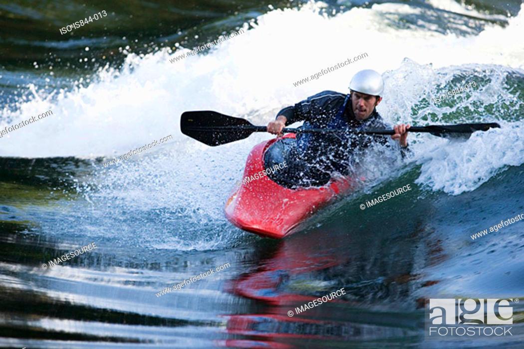 Stock Photo: Man kayaking on river.