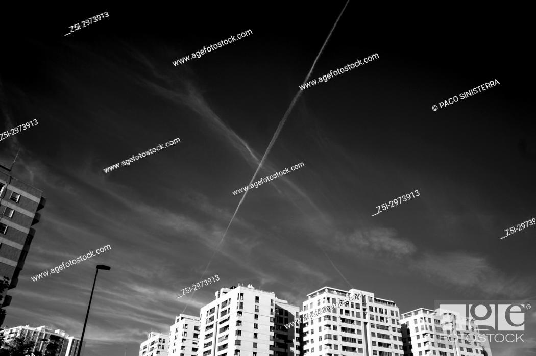 Stock Photo: Residential building and contrail in the sky. Valencia, Spain.