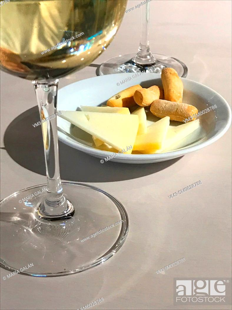 Stock Photo: Glass of white wine with cheese. Spain.
