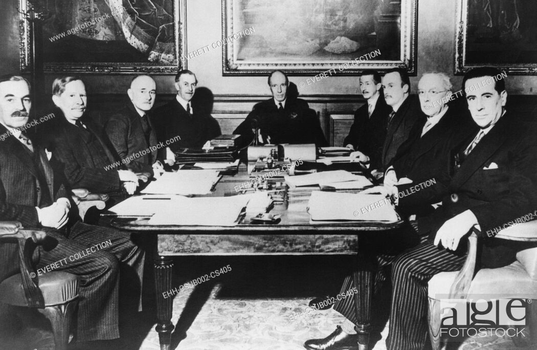 Stock Photo: Lord Halifax, Foreign Secretary in Neville Chamberlain's Cabinet presiding over a meeting. April 16, 1940. He met with Britain's ambassadors to plan for a.
