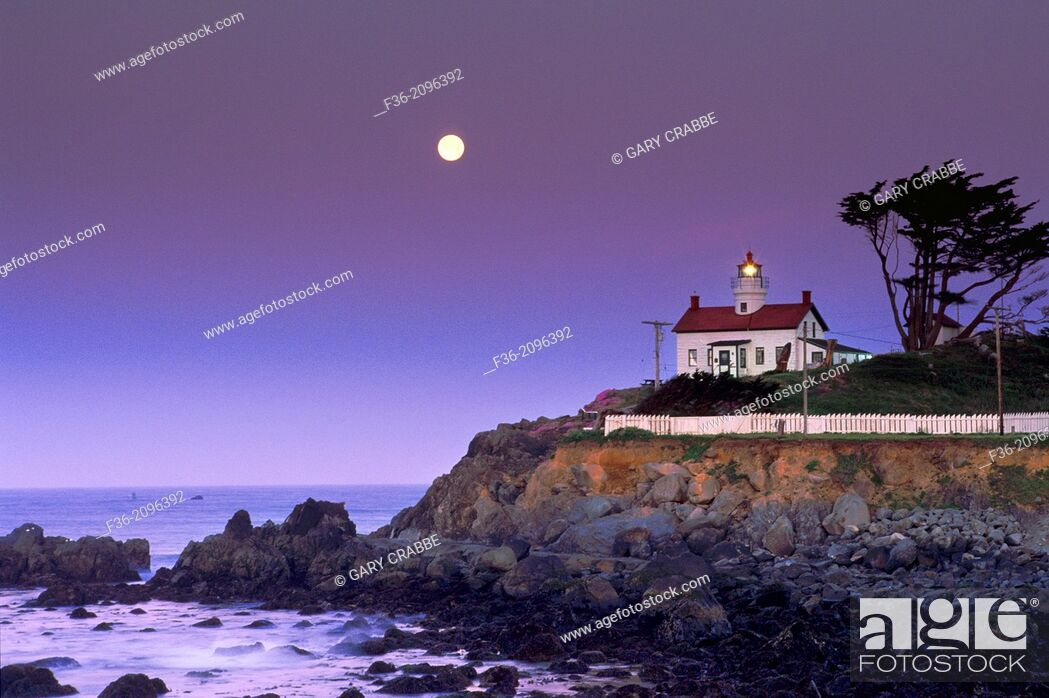 Stock Photo: Full moon setting at dawn over Battery Point Lighthouse, Crescent City, Del Norte County, California.