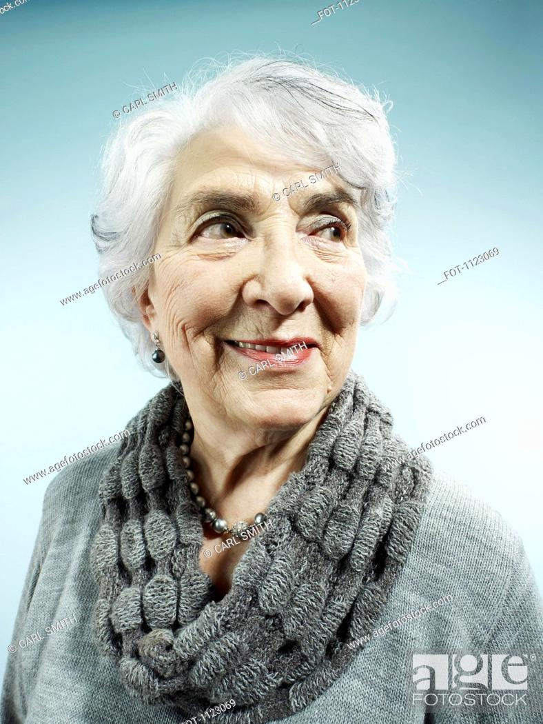 Stock Photo: An elegant senior woman smiling and looking away.