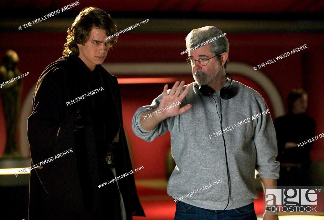 Stock Photo: Hayden Christensen (Anakin Skywalker) listens as Director George Lucas describes the flow of the next shot in Star Wars: Episode III Revenge of the Sith.