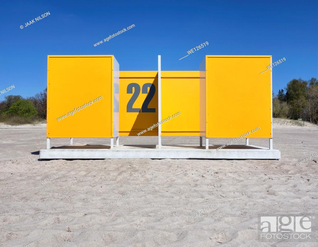 Stock Photo: Yellow dressing cabin, changing cubicle number 22 on empty Pärnu beach in Estonia. Changing room.