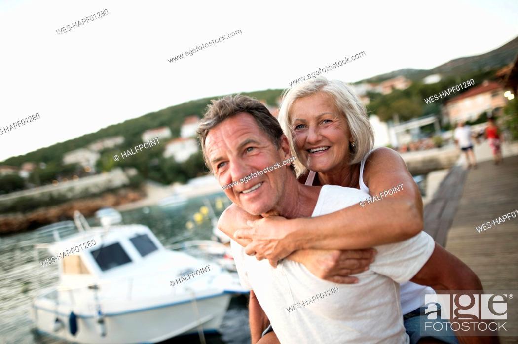 Stock Photo: Portrait of happy senior couple on vacation.