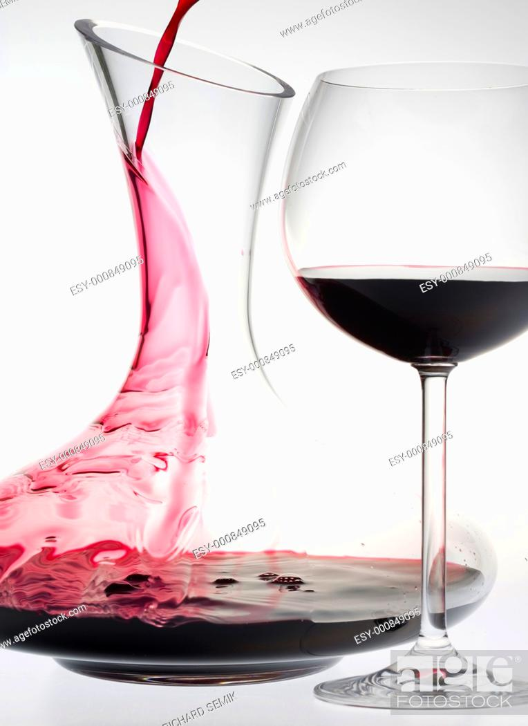Stock Photo: wine glass and carafe with red wine.