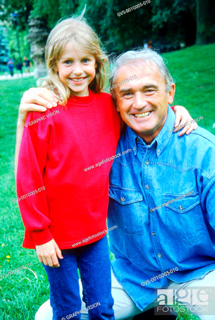 Stock Photo: Portrait of a mature adult and a young girl with their arms around each other.