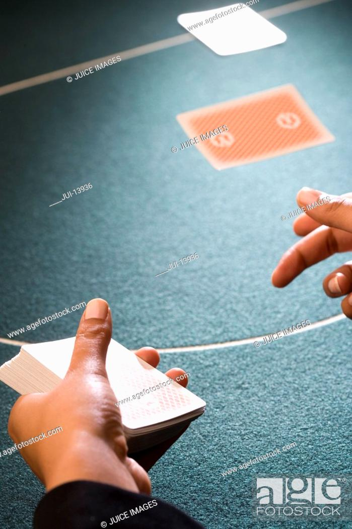 Stock Photo: Croupier dealing cards, close-up of hands.