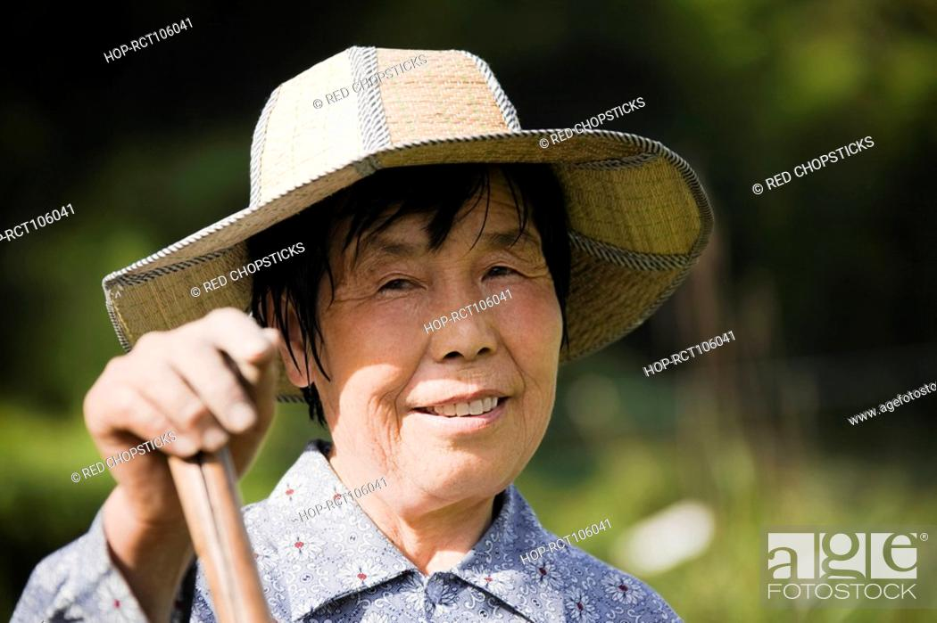 Stock Photo: Portrait of a mature woman smiling, Emerald Valley, Huangshan, Anhui Province, China.