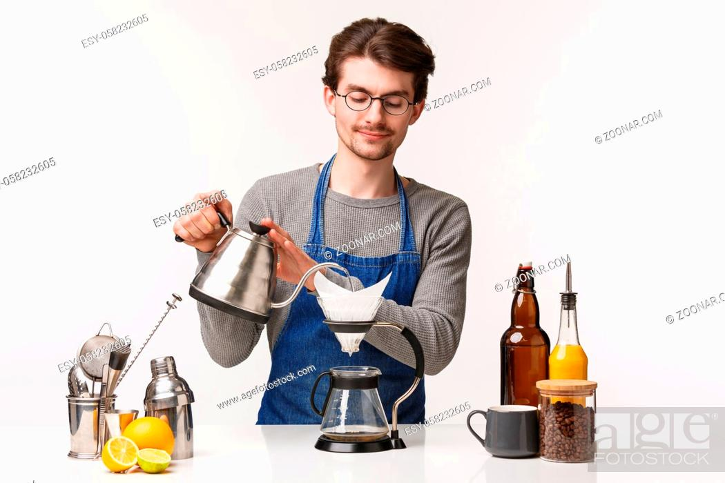 Stock Photo: Barista, cafe worker and bartender concept. Portrait of handsome young male employee making filter coffee pouring water in kettle smiling tenderly.