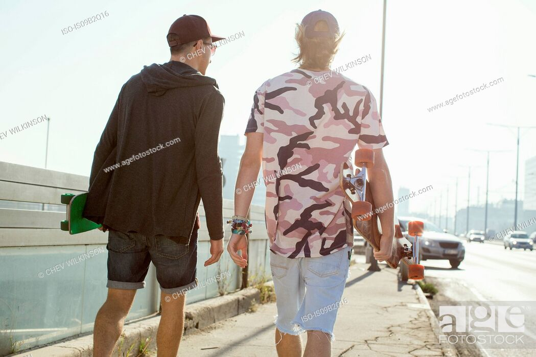 Photo de stock: Skateboarders walking on street, Budapest, Hungary.