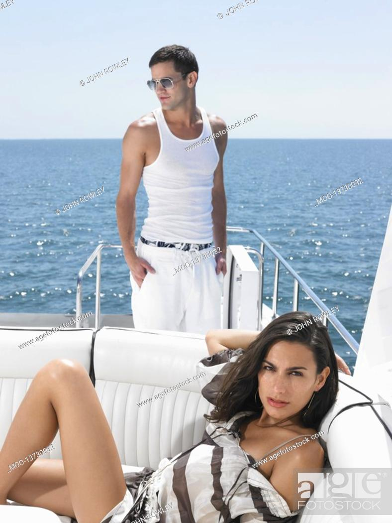 Stock Photo: Young couple on yacht.
