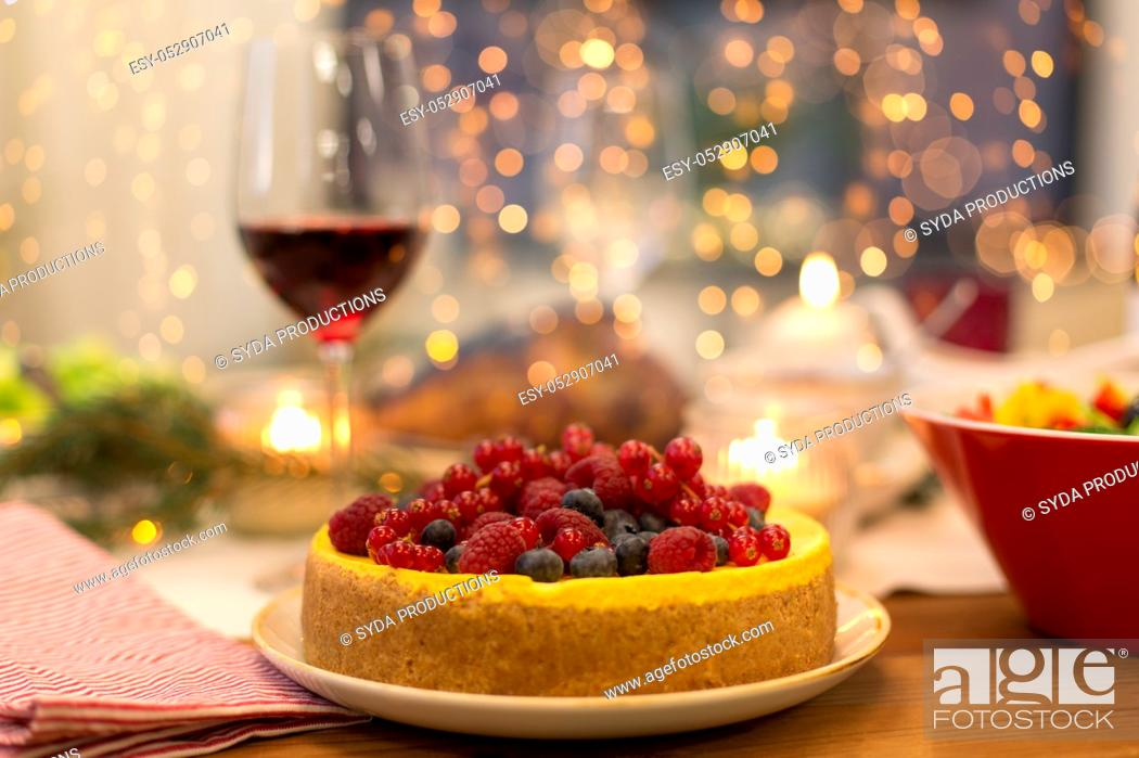 Stock Photo: cake and other food on christmas table at home.