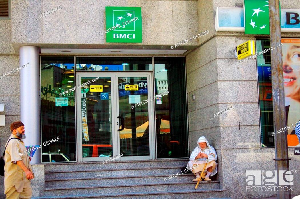 Stock Photo: Man before BMCI bank in Tanger (Morocco).