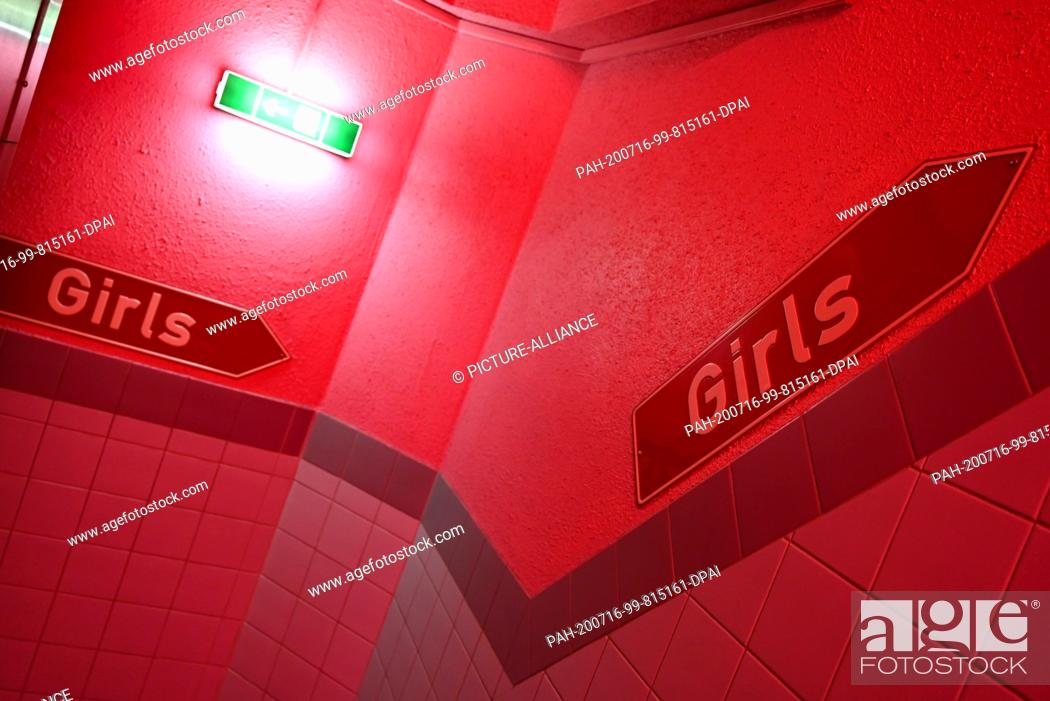 """Photo de stock: 16 July 2020, Hessen, Frankfurt/Main: Signs with the inscription """"""""Girls"""""""" are placed in the staircase of the """"""""Sex Inn"""""""" runway in the Frankfurt train station."""