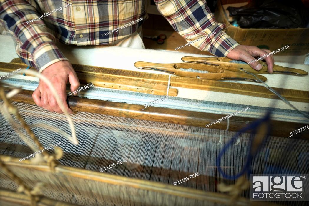 Stock Photo: Close-up of the hands of an unrecognizable man knitting on a loom. Fez, Morocco.