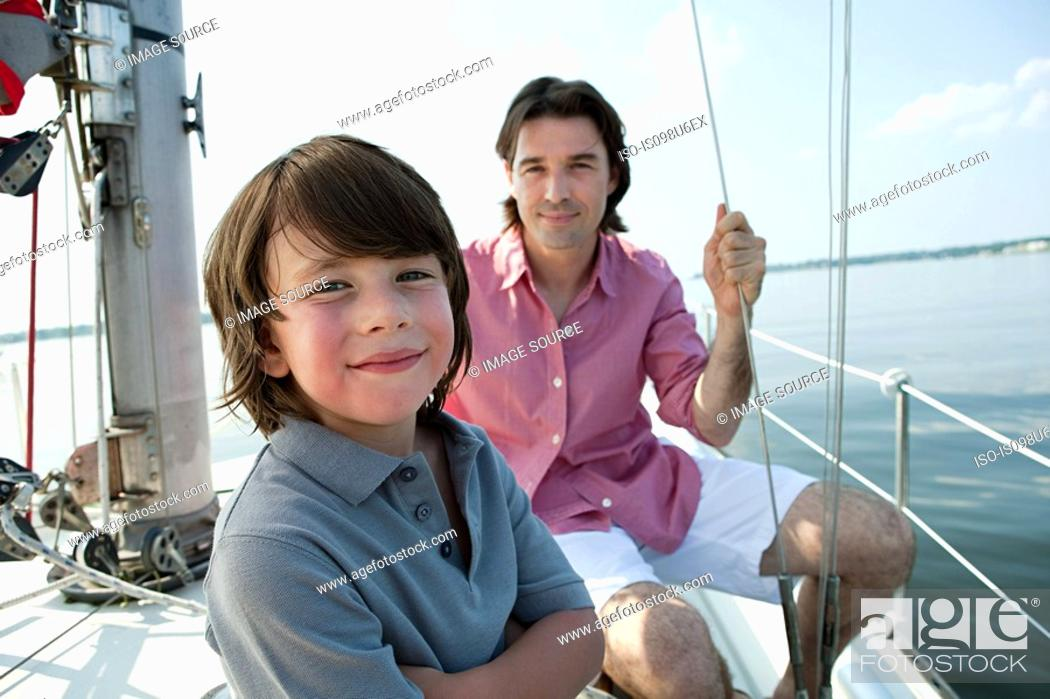 Stock Photo: Father and son on board yacht, portrait.