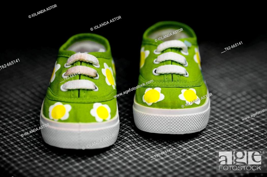 Stock Photo: Green baby shoes.