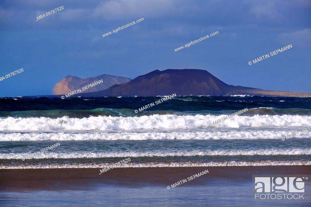 Stock Photo: Sea waves, at Caleta de Famara, behind La Graciosa island, Lanzarote, Canary Islands, Spain.