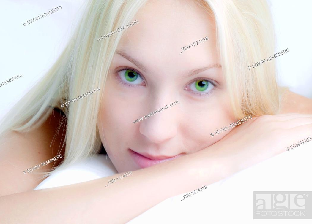 Stock Photo: Blonde woman with green eyes.