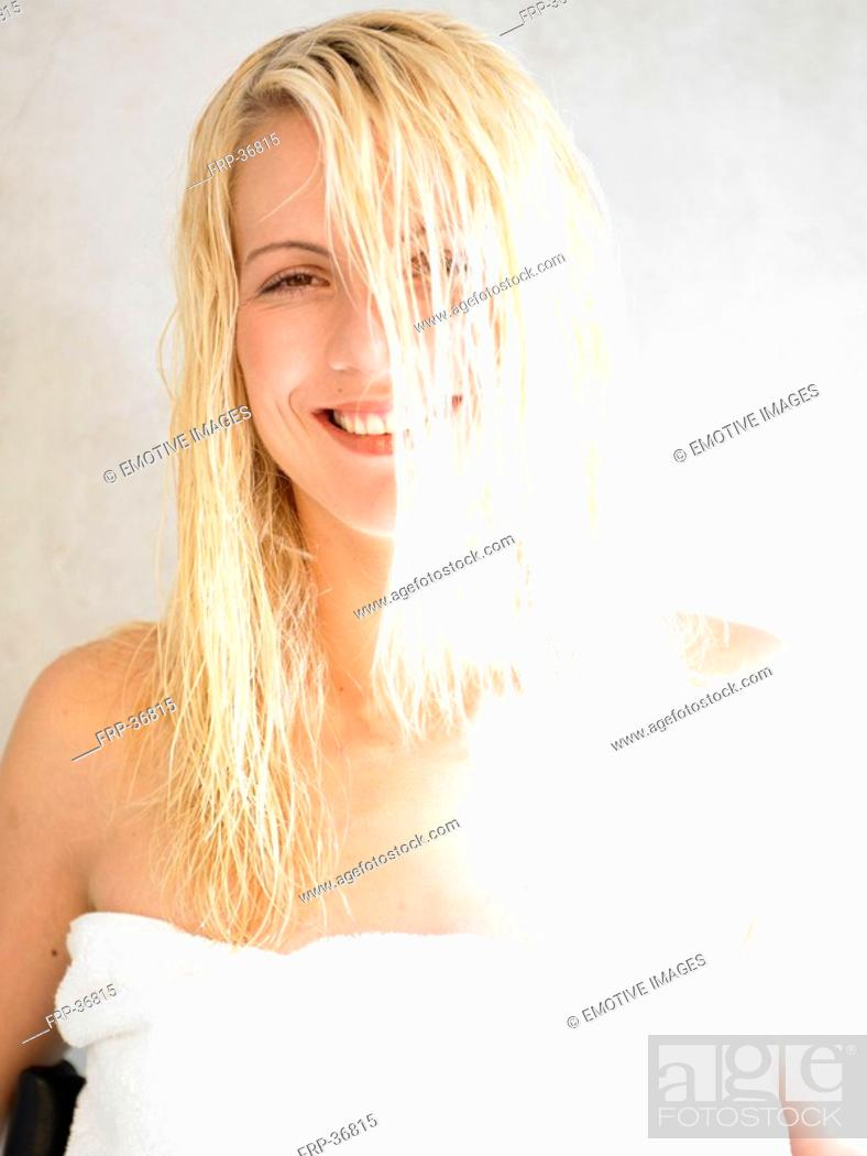 Stock Photo: Young woman after hair washing.