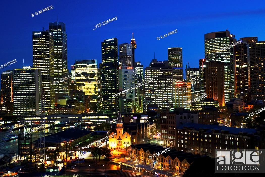 Stock Photo: Sydney downtown skyline at dusk seen over The Rocks district.