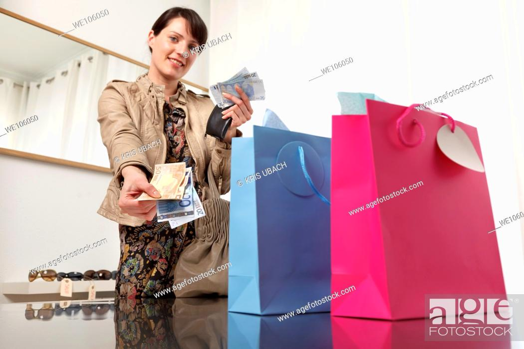 Stock Photo: Woman in a clothes shop.