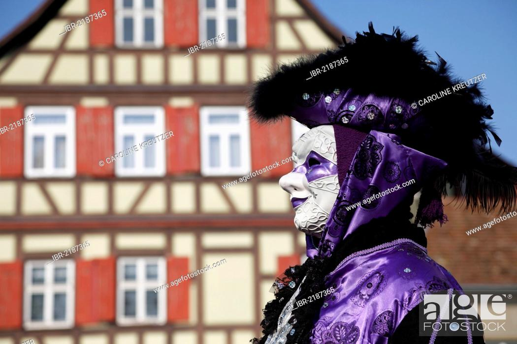 Stock Photo: Man wearing a mask standing in front of half-timbered house, Hallia Venezia carnival, Schwaebisch Hall, Baden-Wuerttemberg, Germany, Europe.