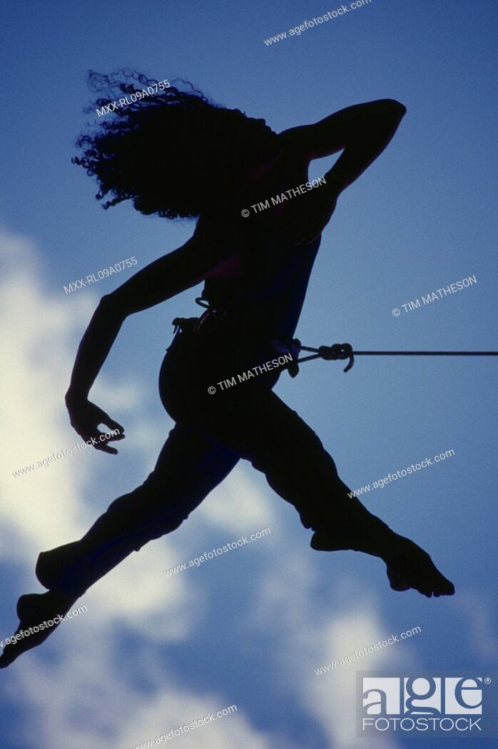 Stock Photo: Silhouette of woman climbing.