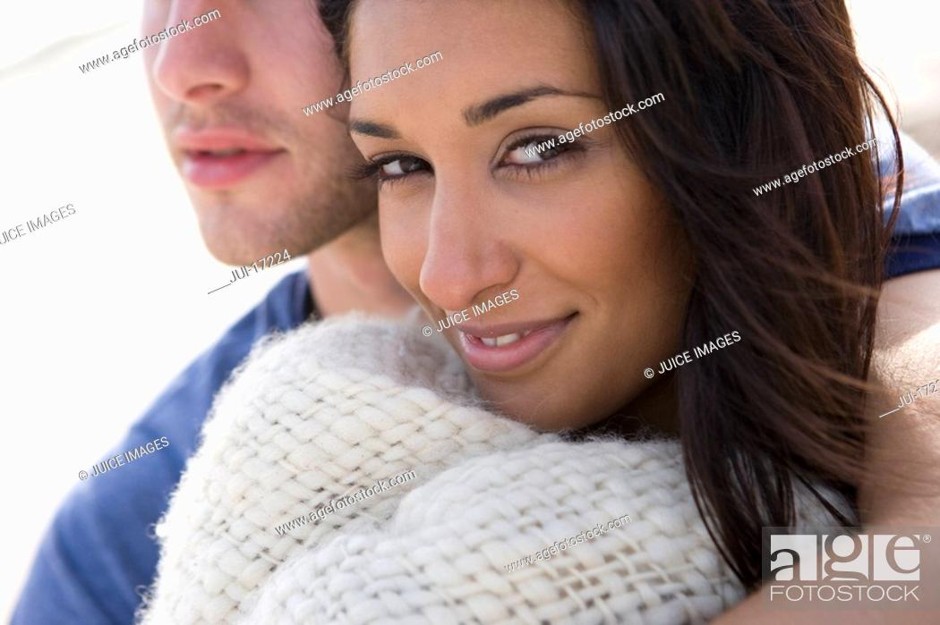 Stock Photo: Young couple hugging at beach, close-up.