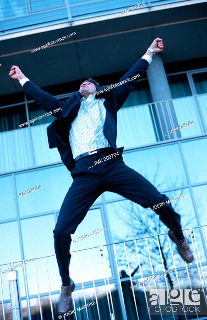 Stock Photo: A salesman, businessman, tradesman, employee, officer, young man jumping for joy, jubilating.