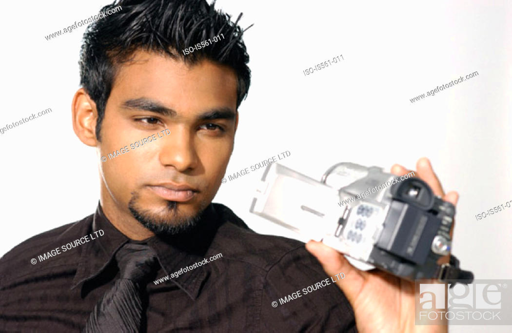 Stock Photo: Man using video camera.