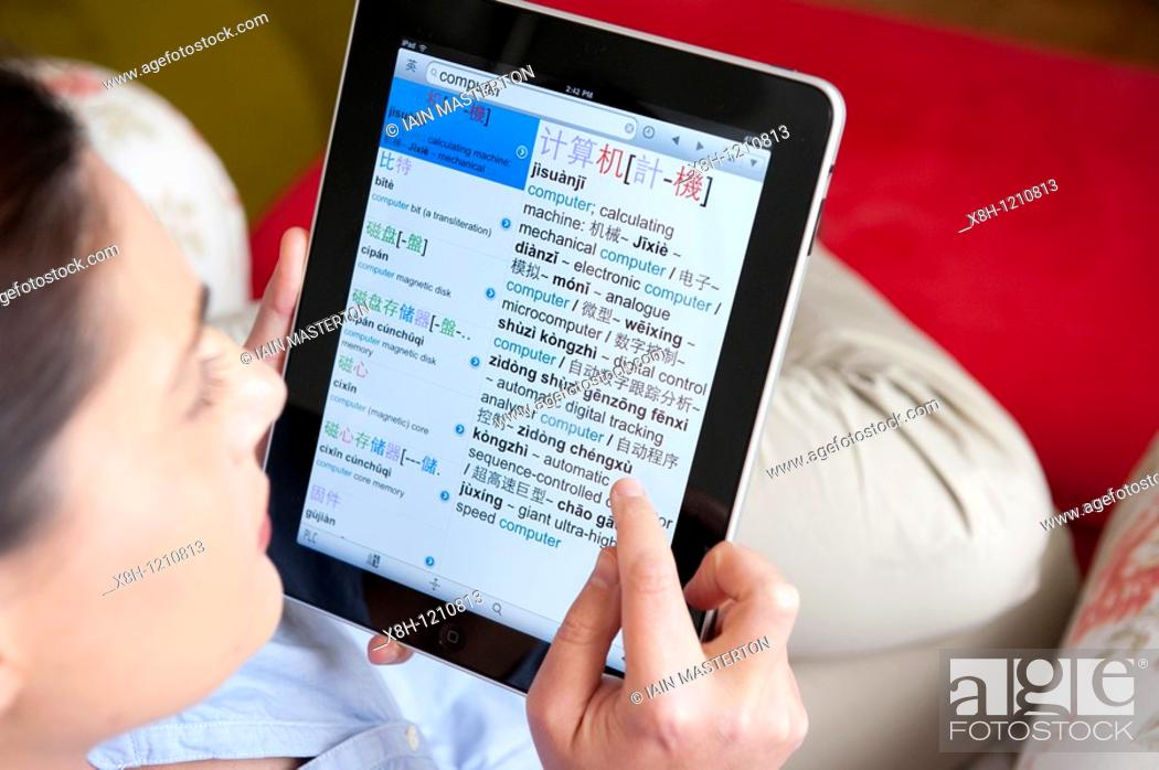 Woman studying Chinese language using iPad tablet computer