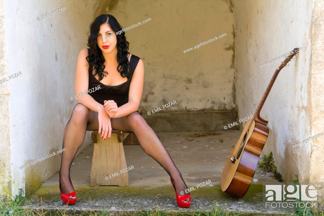 Stock Photo: Pretty woman and a guitar.