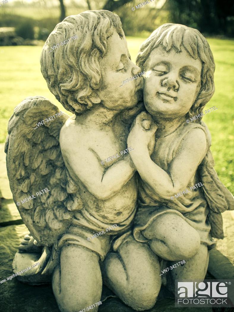 Stock Photo: Cupids garden sculpture.