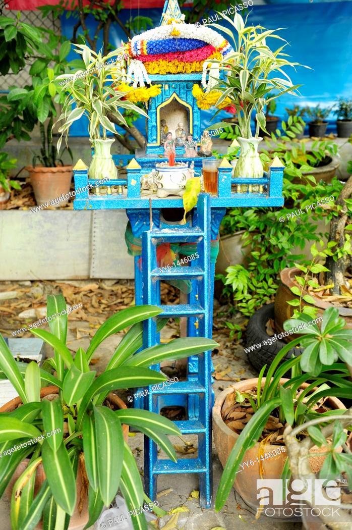 Stock Photo: spirit house in the garden of Wat Santithammaram, temple famous for ordinations, thonburi, Bangkok, Thailand.