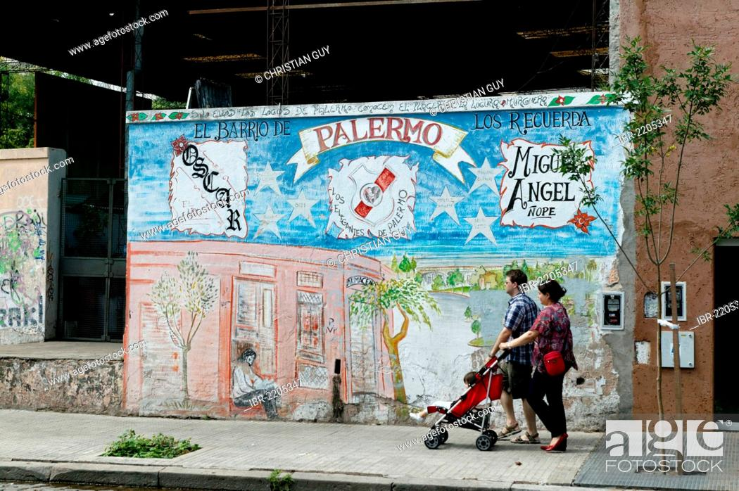 Family passing painted house, Palermo Viejo district, Buenos Aires ...