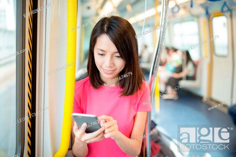 Stock Photo: Woman use of mobile phone at train.