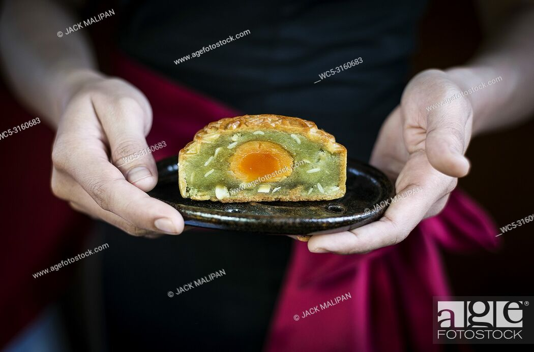 Stock Photo: waitress serving gourmet traditional chinese festive mooncake pastry dessert.